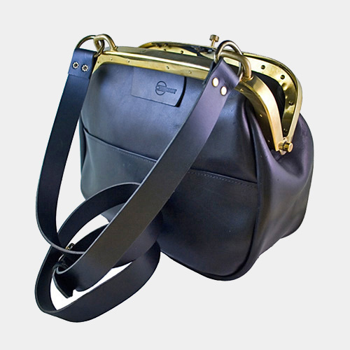 Cambist conductors bag, genuine leather with solid brass details.